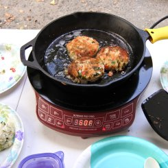 Flipped crab cakes and cooked the other side