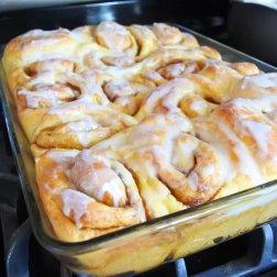 Add glaze to warm rolls